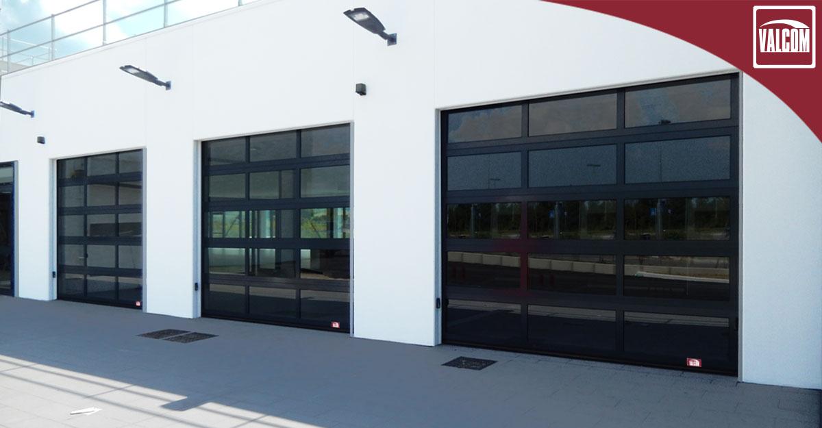 Portoni sezionali full vision Valcom per BMW a Cesena